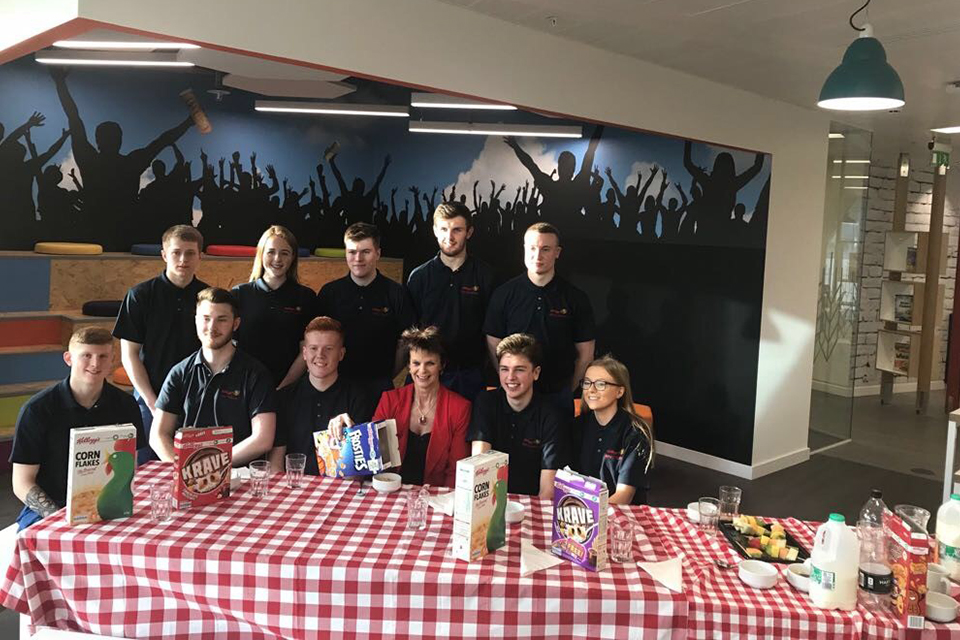 Apprenticeship and  Skills Minister Anne Milton sharing breakfast with apprentices from Kelloggs
