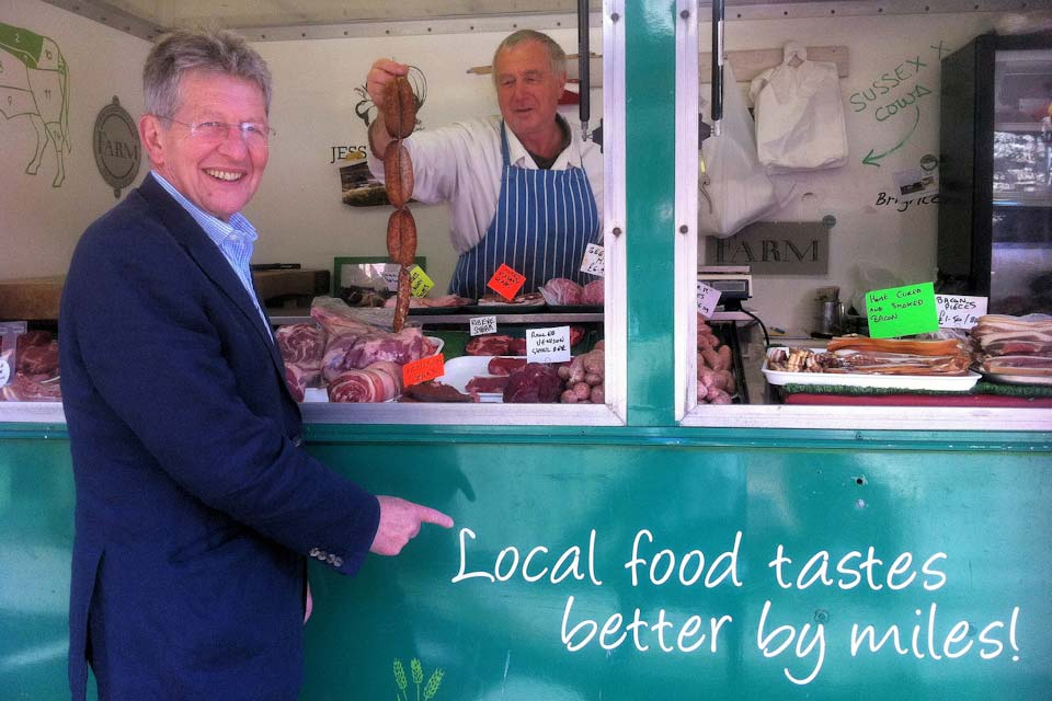 Don Foster at a butcher's stall