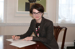 Minister for the Constitution signs the Regulations