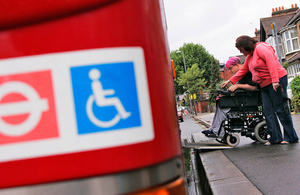 Picture of wheelchair user getting onto an accessible bus.