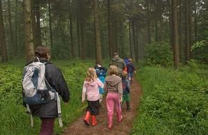 People walking through Wendover Woods