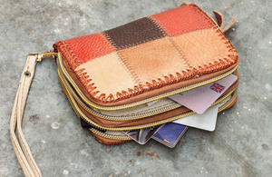 Purse with a driving licence tucked into slot