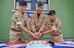 Members of the Queen's Gurkha Signals from 22 Signal Regiment cut their birthday cake [Picture: Corporal Pete Devine, Crown Copyright/MOD 2011]