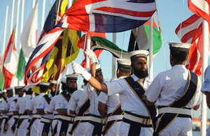 Sailors of the Pakistan Navy conduct the opening ceremony for Exercise Aman with the flags of all participating nations [Picture: Leading Airman (Photographer) Maxine Davies, Crown copyright]