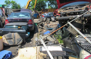 Photo of various cars partly dismantled all heaped together