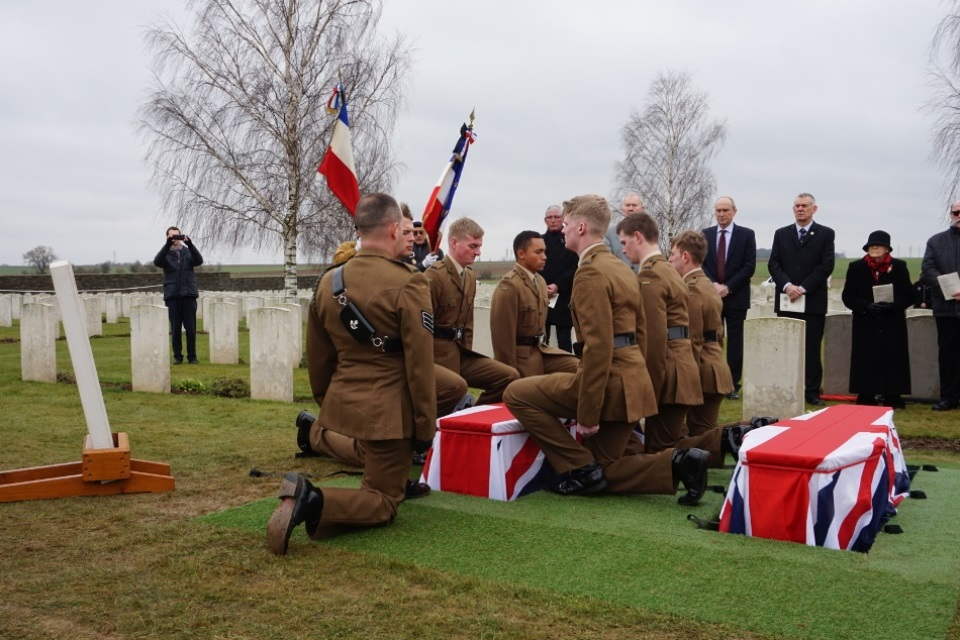 Members of the 3 Rifles Regiment prepare to lower the coffin of the unknown Durham Light Infantry soldier, Crown Copyright, All rights reserved