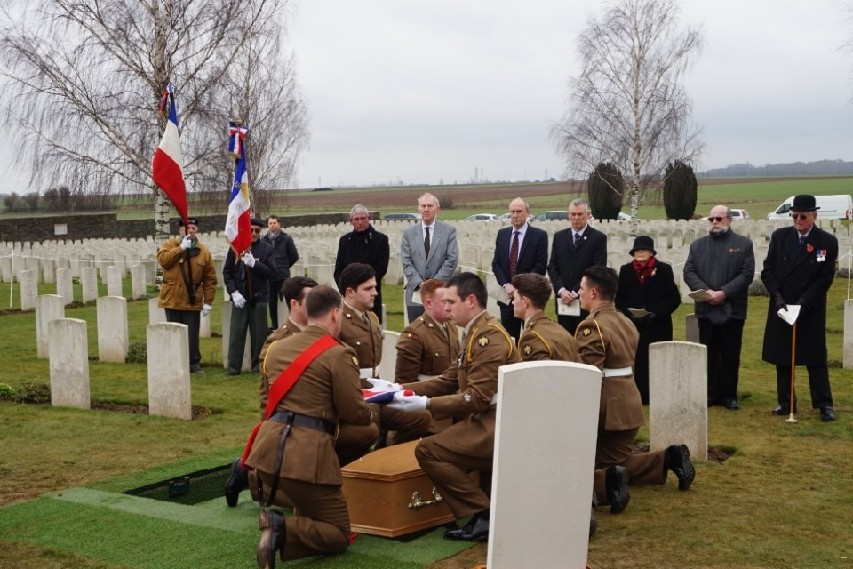 Royal Anglians Regiment folding the flag for the unknown Bedfordshire soldier, Crown Copyright, All rights reserved