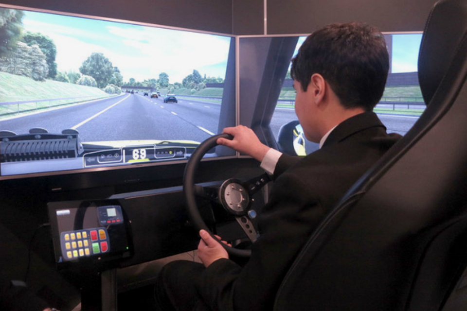 Image showing a Big Bang Fair visitor using the Highways England simulator