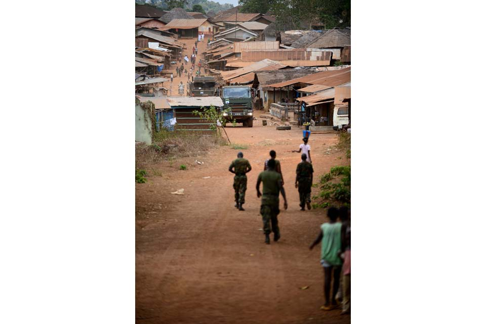 The military engineers drive through a town in Sierra Leone