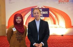 The British High Commissioner, Thomas Drew with the winner of the Great Debate, Muhiba Ahmed.