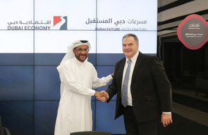 ObjectTech chief executive, Paul Ferris (right), signs an agreement with Ali Ibrahim, Deputy Director General of Dubai Economy.