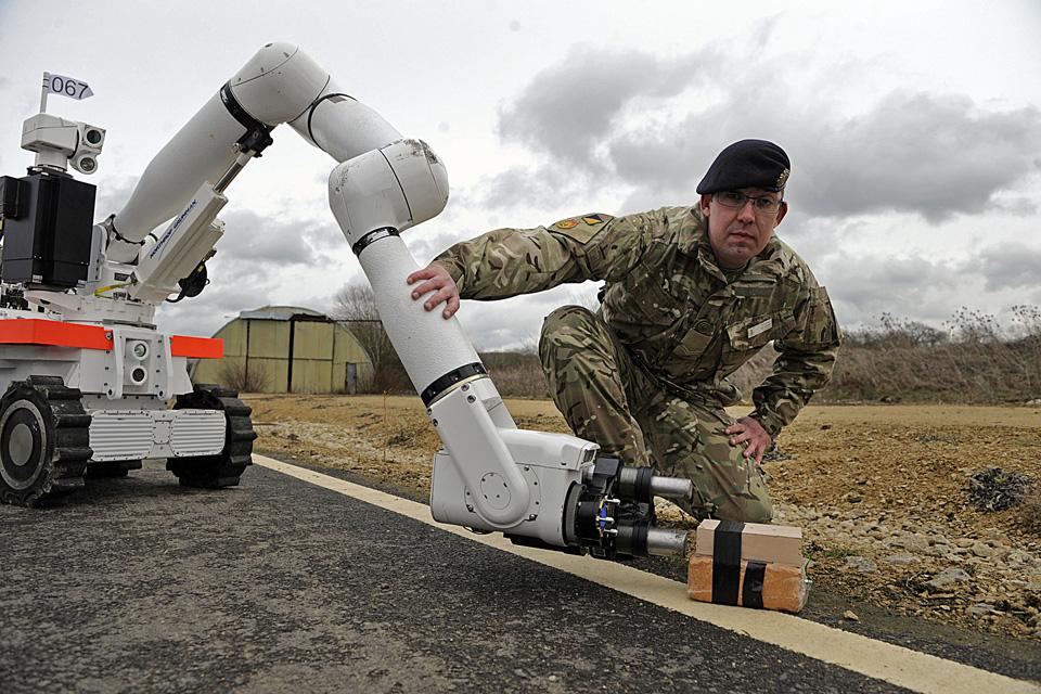 Soldier with a Cutlass bomb disposal robot