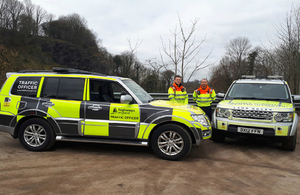 Traffic officers with Highways England vehicles