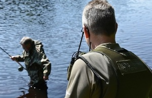 Images shows fisheries enforcement officer on patrol