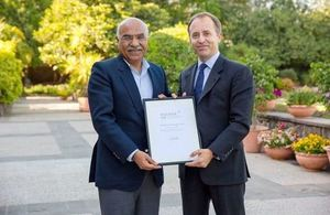 The British High Commissioner Thomas Drew presenting Commonwealth Point of Light award to Dr Muhammad Amjad Saqib