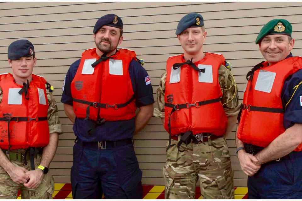 L-R Corporal Phillips, POMA Nicholl, Flt Lt Lowry and Lt Cdr Middleton.