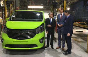 Greg Clark standing by a van in the Vauxhall plant.