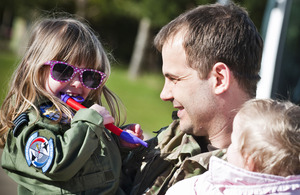 Flight Lieutenant Mark Longstaffe is welcomed back to RAF Marham by his family [Picture: Corporal Paul Oldfield RAF, Crown copyright]