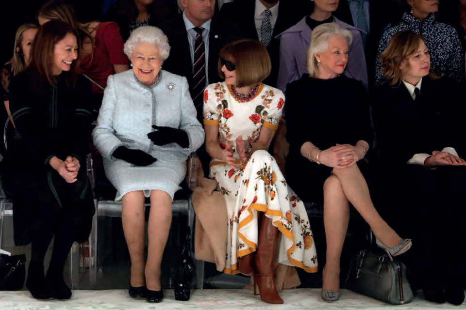 The Queen sitting in the front row at Fashion Week.