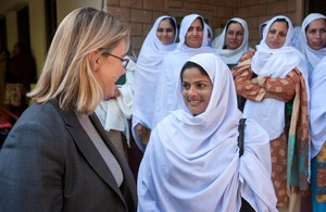 Justine Greening meets lady health workers during a visit to a health clinic in Islamabad. Picture: Usman Ghani/ DFID