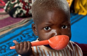 A severely malnourished child feeds himself nutritionally balanced milk in a nutrition unit in Niger. Picture: Gonzalo Höhr/Action Against Hunger