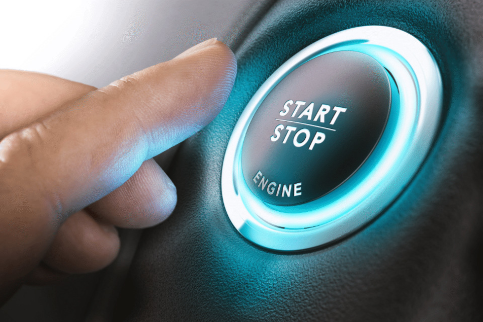 Finger about to press an engine start button (credit: Olivier le Moal/Shutterstock - ID549305095).