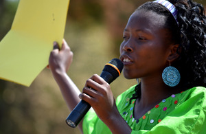 A woman speaks into a microphone at a public declaration for the abandonment of female genital cutting (FGC) in Ziguinchor, Senegal. Picture: Tostan International