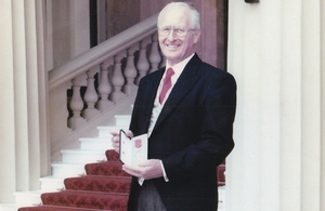 Frank Blewett with his OBE in 1998