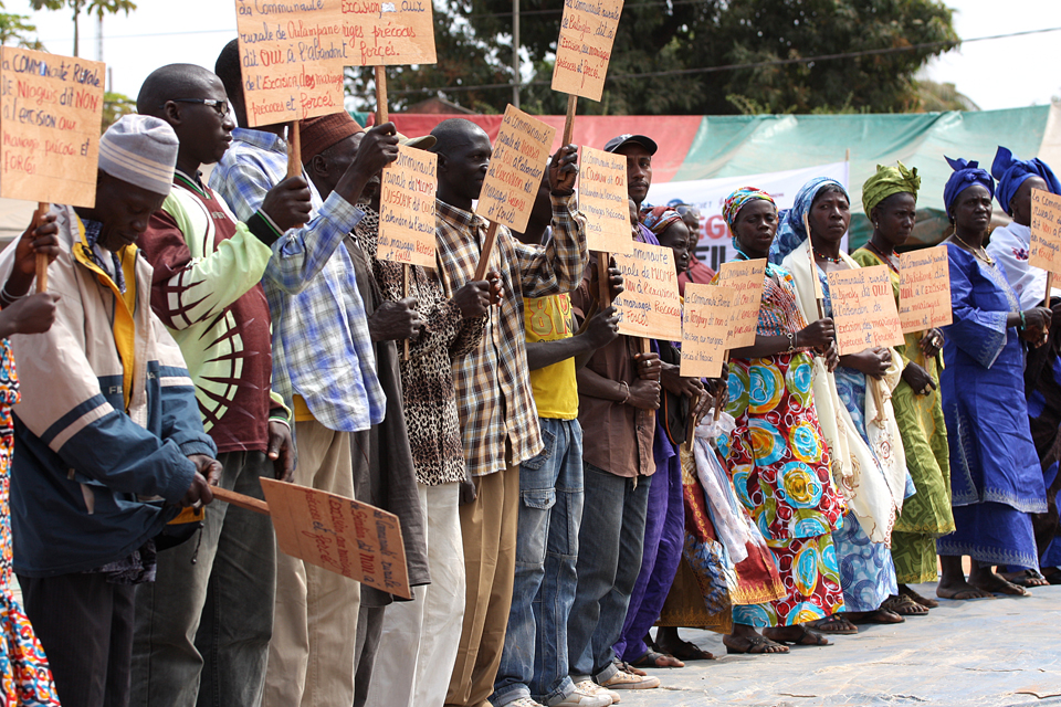 A group of men and women holding up signs. Picture: Tostan International