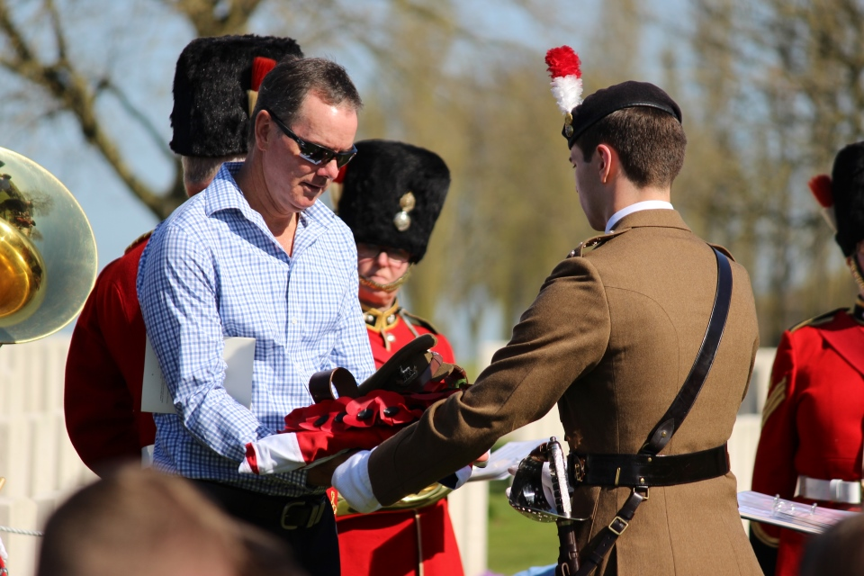 Great nephew Alistair Innes-Walker receives the Union Flag from Captain Alex Edmund, Crown Copyright, All rights reserved