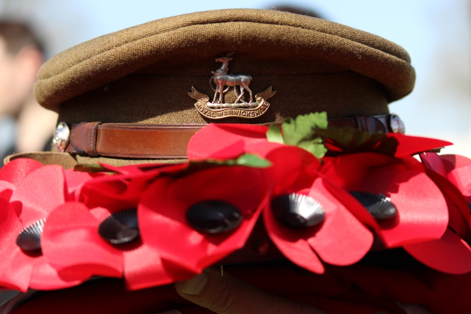 Royal Warwickshire cap amongst poppy wreath, Crown Copyright, All rights reserved