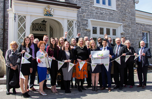 British High Commissioner to Canada stands with students of the Royal Commonwealth Society to celebrate their Commonwealth Big Lunch outside of her official residence Earnscliffe.