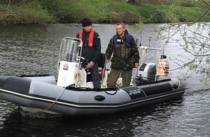Image shows fisheries officers on the boat
