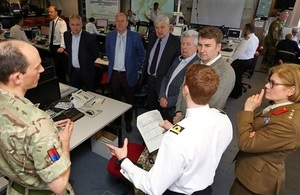 MSPs observing Exercise Joint Warrior listen to a briefing at HMNB Clyde.