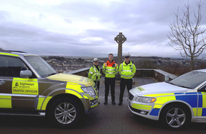 Traffic officers and police with hi-vis cars
