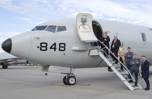 Defence delegates boarding a P8-A Poseidon at RAF Lossiemouth