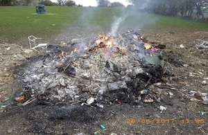 Image shows burning waste on the land