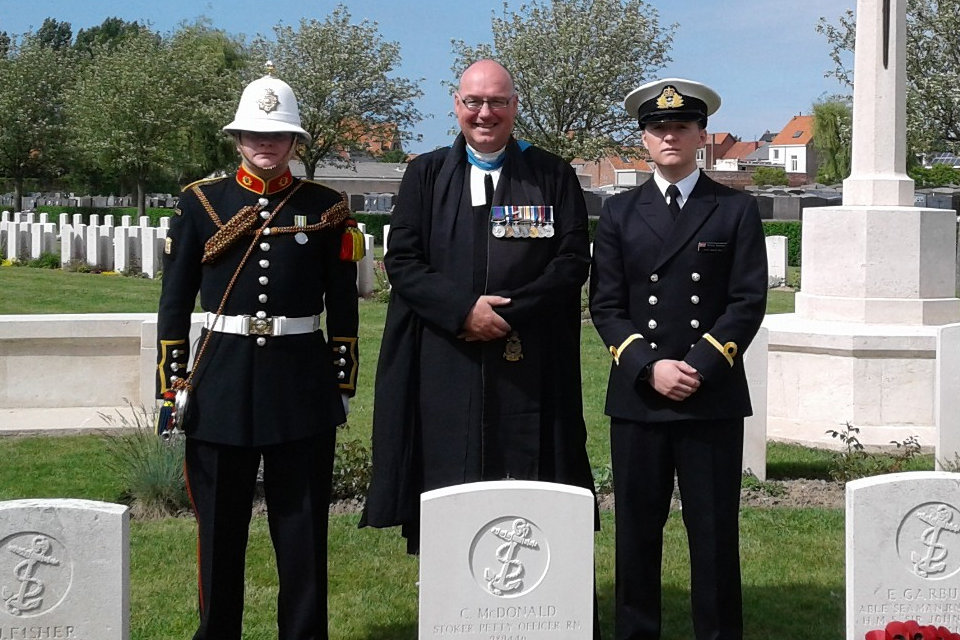 Reverend (Professor) Scott J S Shackleton is joined by Navy representatives by PO McDonald's new headstone, Crown Copyright, All rights reserved
