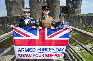 Armed Forces Personnel with the Armed Forces Day Flag
