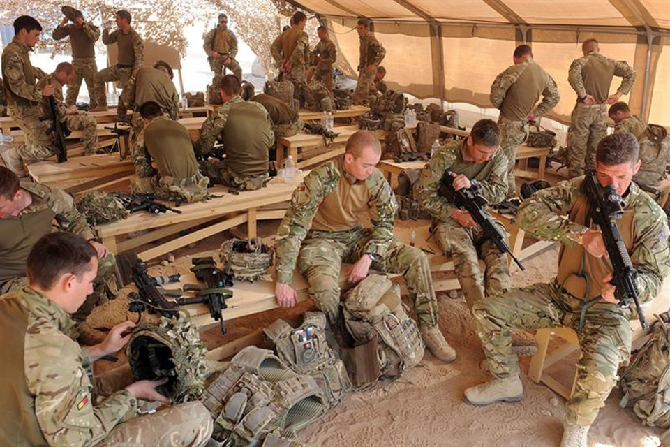 Soldiers from 1st Battalion The Royal Anglian Regiment cleaning their weapons