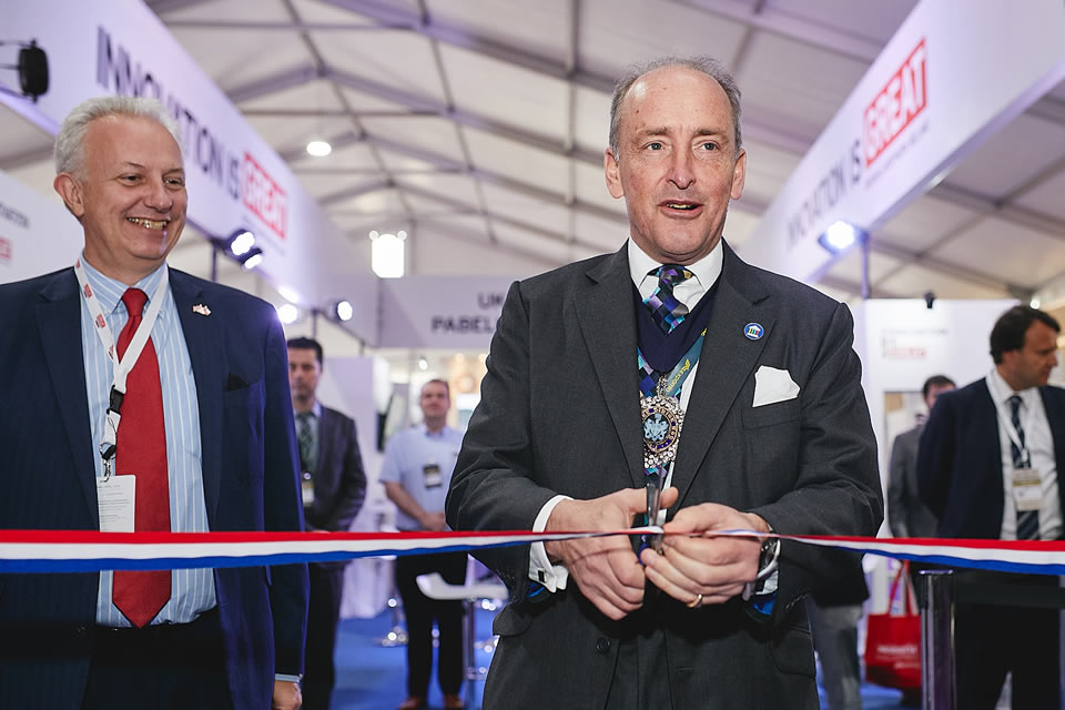 Picture of Charles Bowman cutting the tape to inaugurate the British Pavilion at Expomin 2018.
