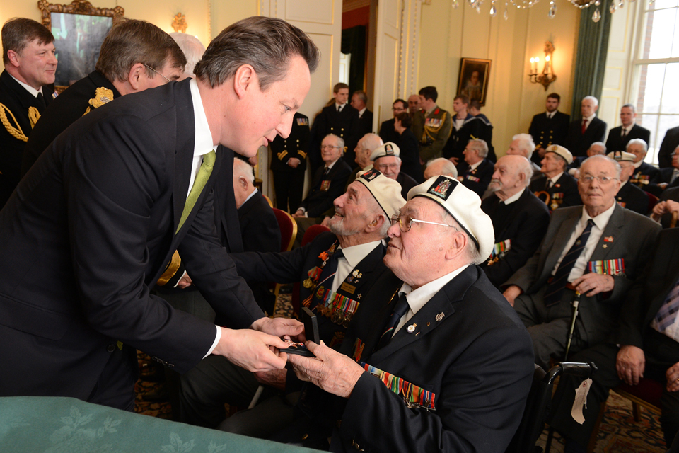 Prime Minister David Cameron presents a veteran with an Arctic Star medal