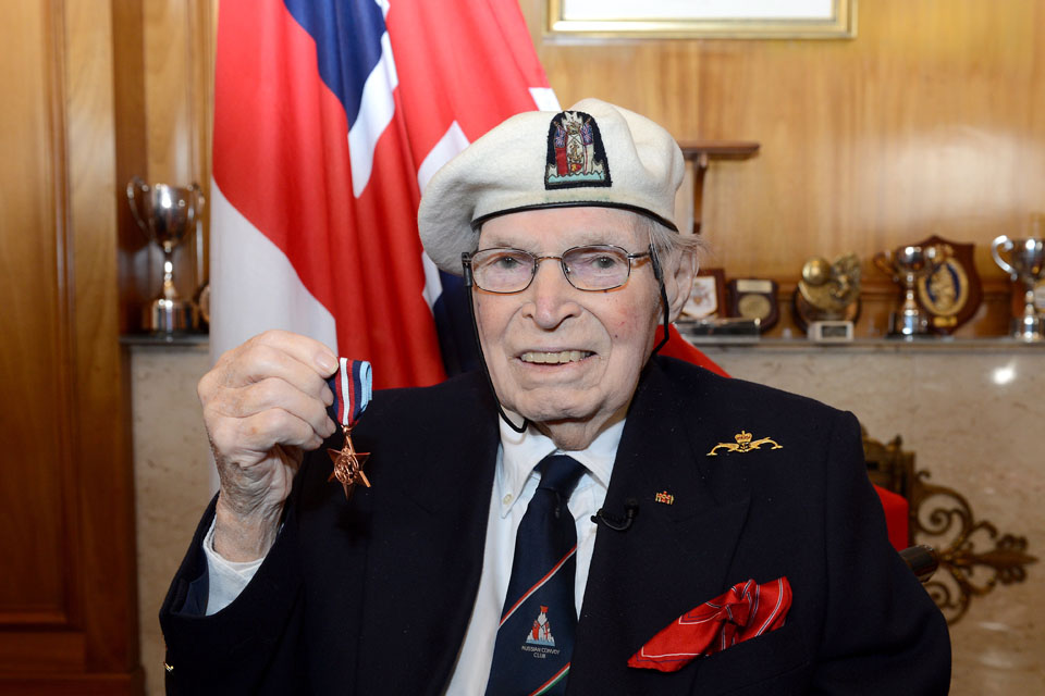 Commander Eddie Grenfell Royal Navy (Retired) with his Arctic Star medal
