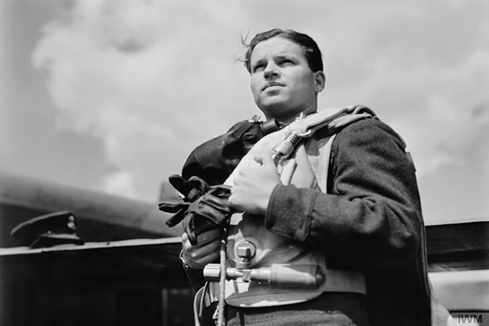 Wing Commander Guy Gibson, while Commanding Officer of No 617 Squadron RAF, wearing flying kit.