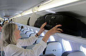 Passenger on plane with luggage