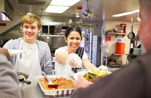 Young people serving food
