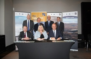 DIO Commercial Director Jacqui Rock, Director Navy Support Matt Harrison, Navy Command and the Clyde Commercial Team sign framework agreement.