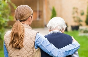 Care home resident accompanied by a carer