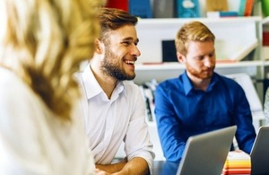 Cheerful coworkers in a meeting via nd3000 Shutterstock