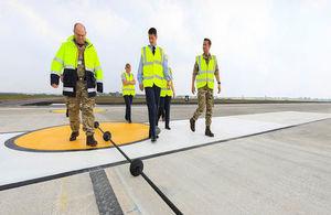 RAF Marham Station Commander, Gp Capt Ian Townsend and team inspecting the Rotary Hydraulic Arrestor Gear on the newly-resurfaced runway.